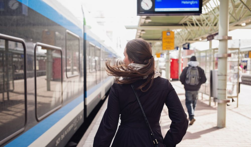 A student is boarding a commuter train.