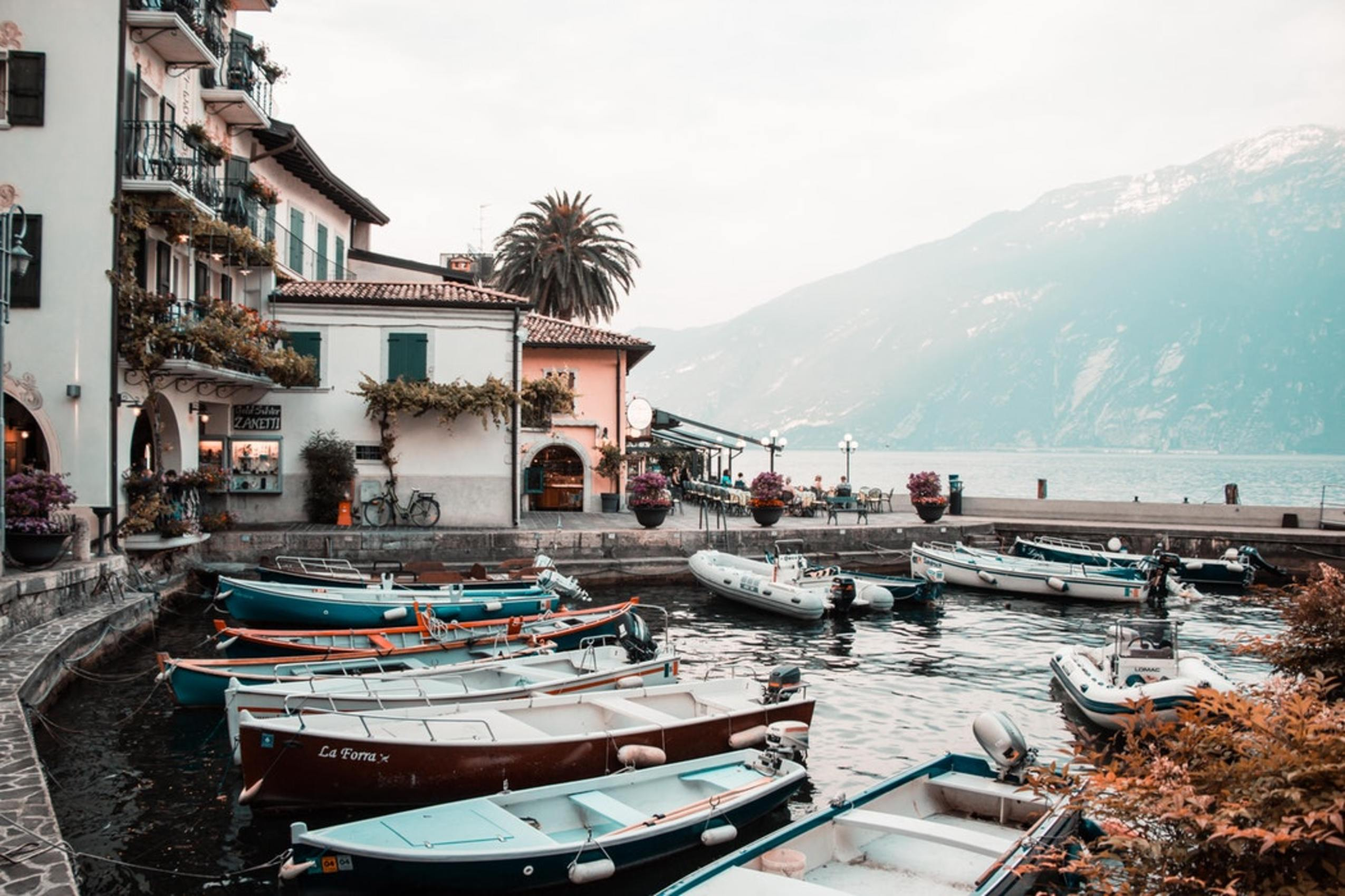 Boats and villas by Lake Garda in Italy