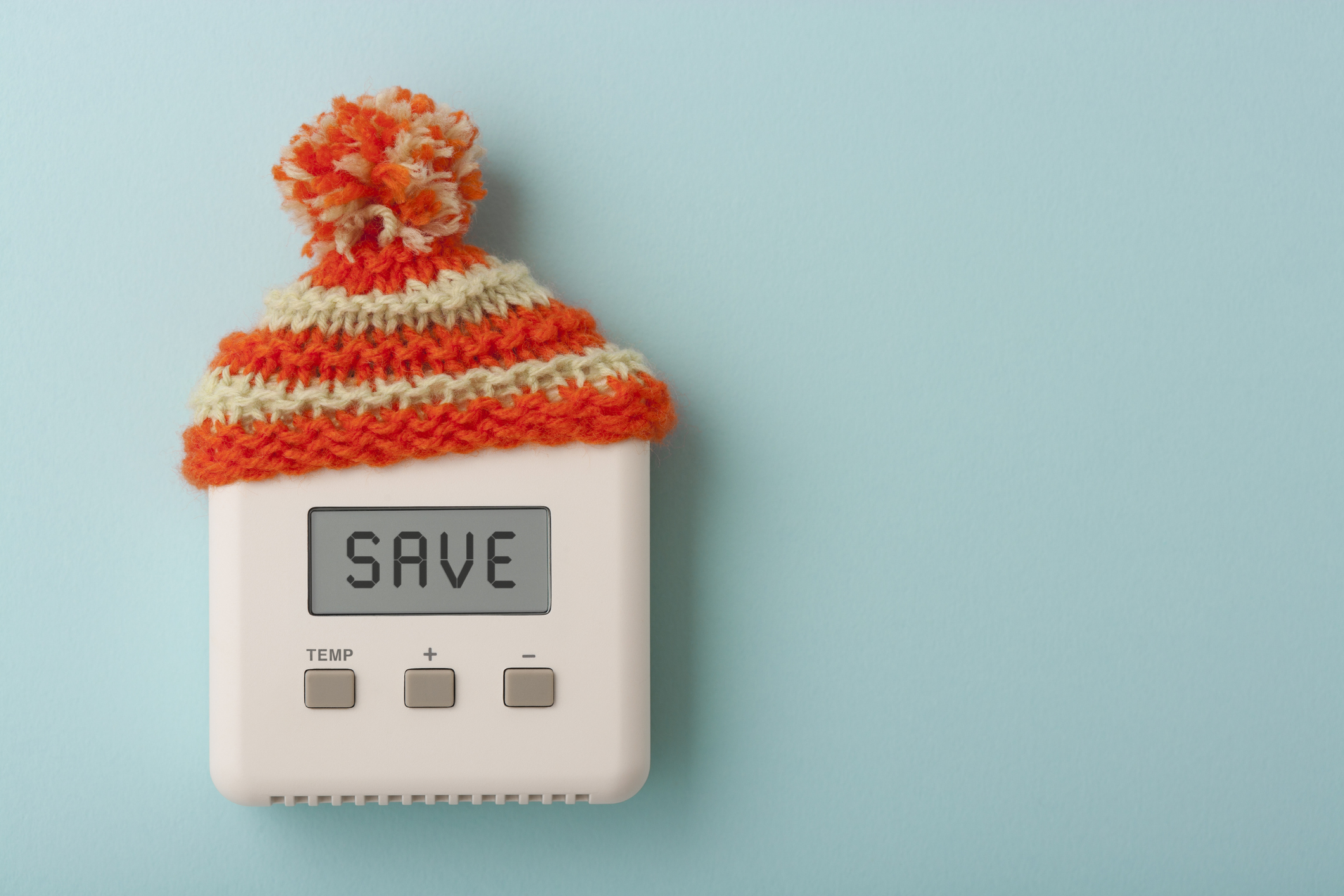 Thermostat with a winter hat.