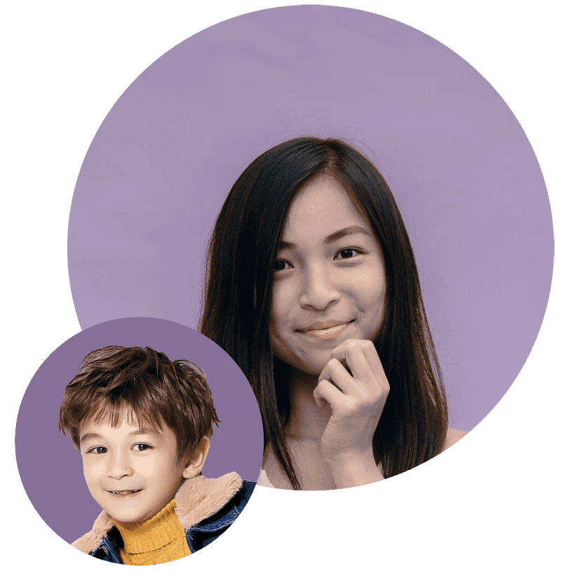 smiling little boy with brown hair and friendly female tutor