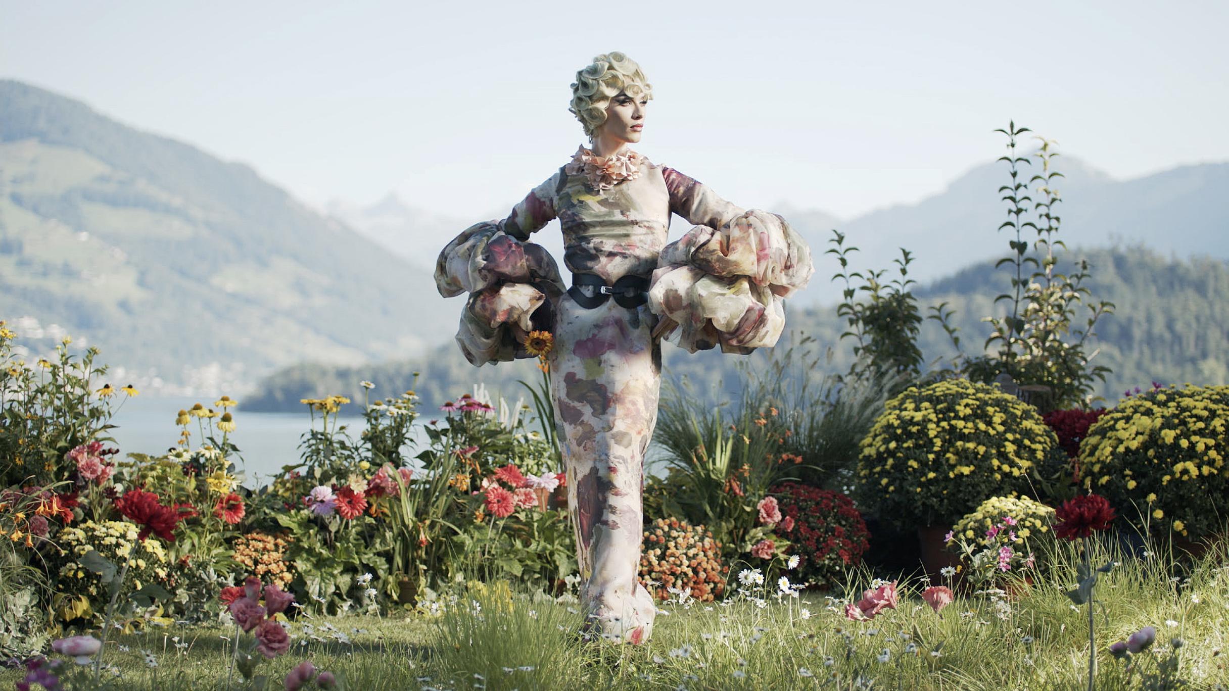 Miss Fame outside in flower landscape