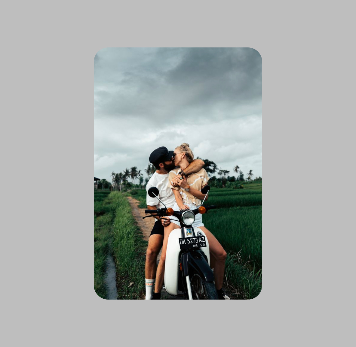 Couple embracing on a motorcycle