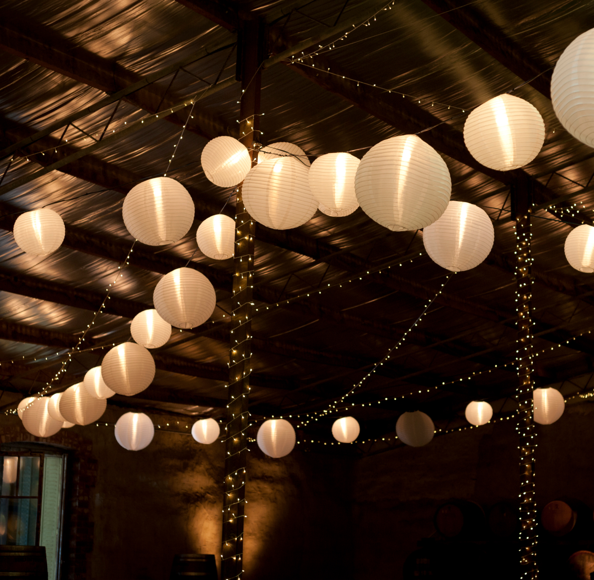 A string of Chinese white paper lanterns
