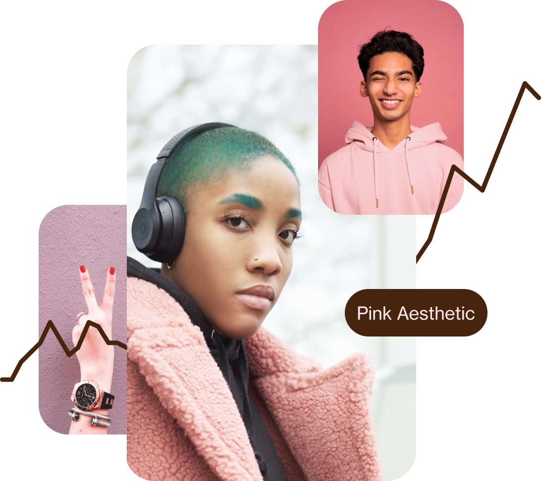White fingers with red nail varnish forming a peace sign. Black woman with short green hair dressed in a pink coat. Winking South Asian man dressed in a pink hoodie.