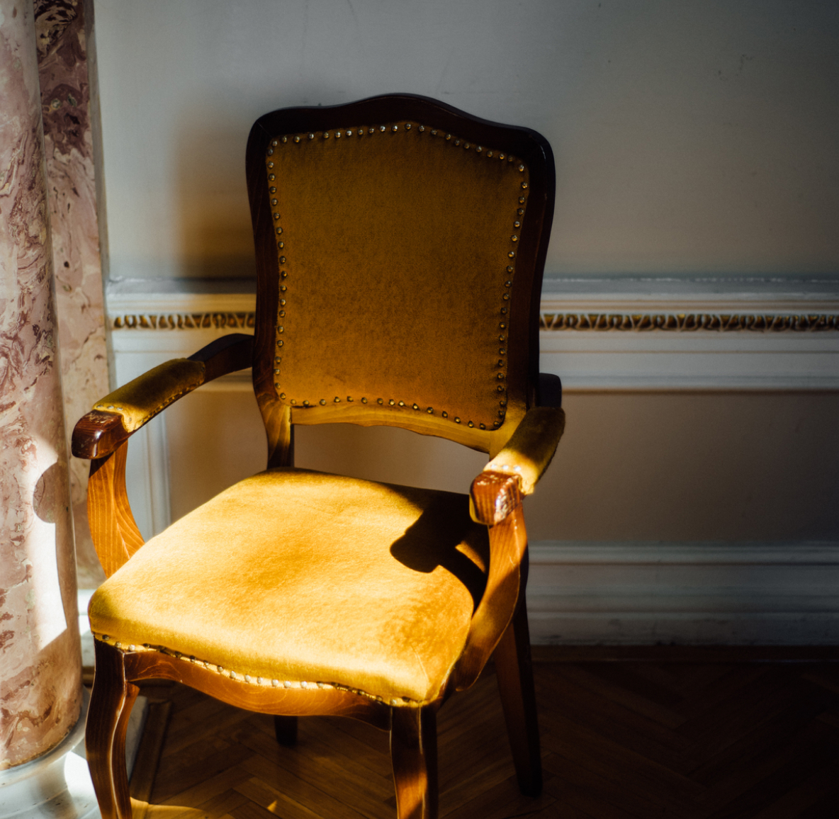 Sunlight cast on an antique armchair