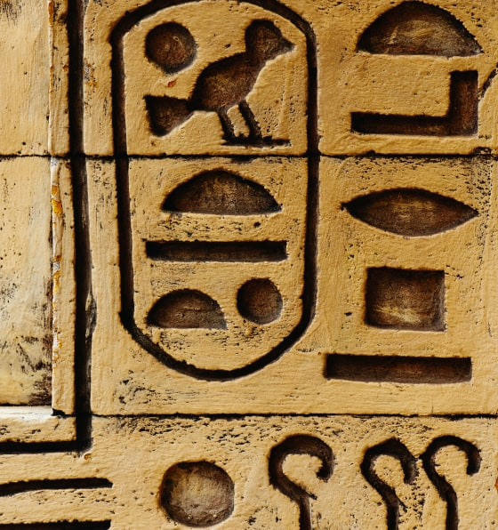 Hieroglyphs etched in tan stone