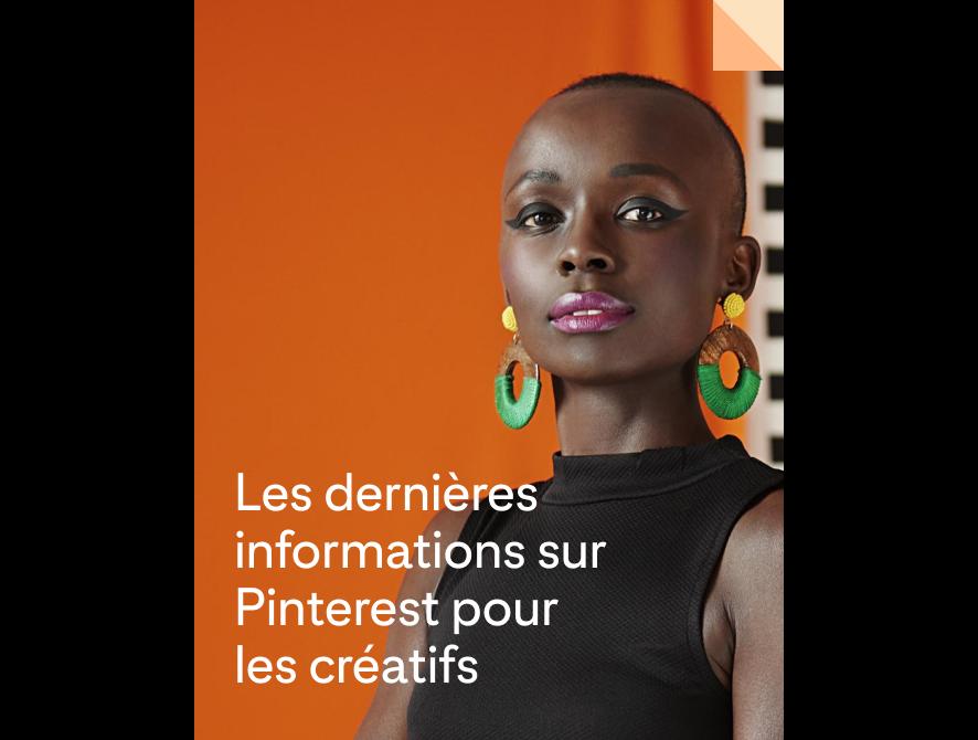 Femme noire portant un maquillage audacieux et des boucles d'oreille colorées
