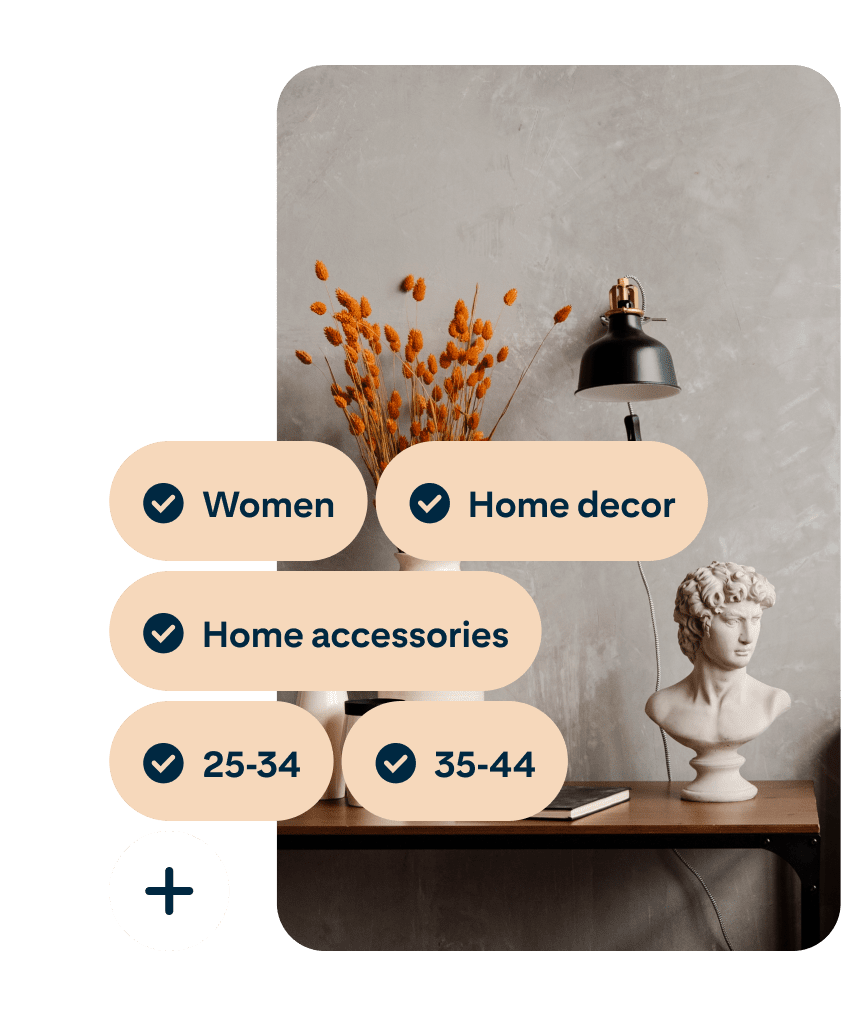 A Pin showing a desk with a vase of orange flowers, a black lamp and a bust of Michelangelo's David with the search terms Women, Home decor, Home accessories, 25 to 34 and 35 to 44