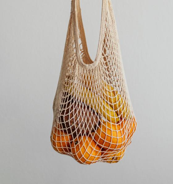 A mesh bag of oranges