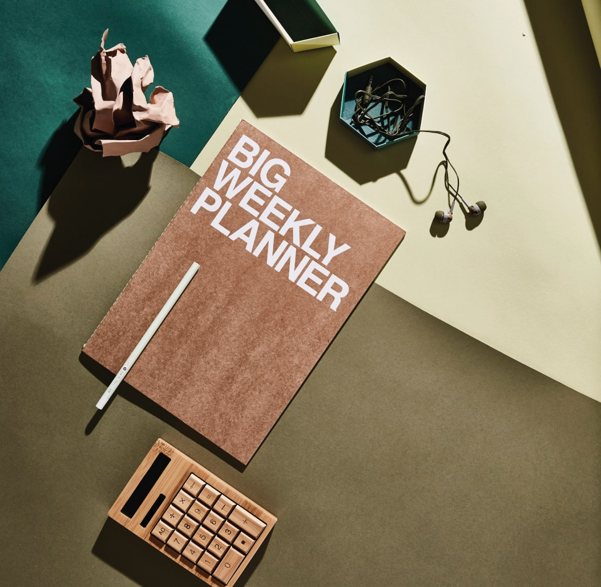 Desk accessories including a chic weekly planner, geometric paper weights and a mini calculator