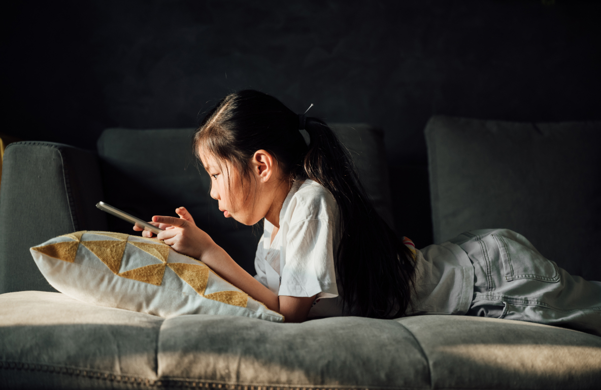 Young girl watching entertainment on her tablet