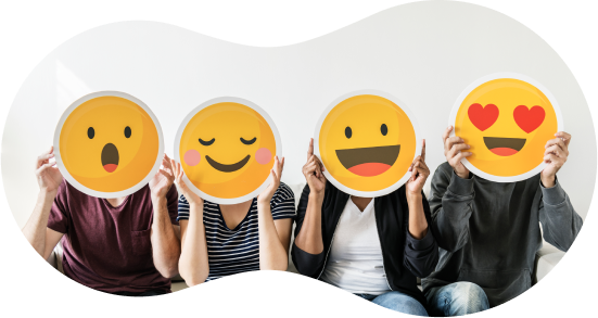 Four people holding Facebook emojis over their faces.