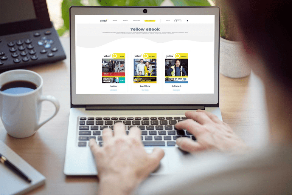 Image of a person typing on his Laptop, searching on our Yellow eBooks landing page.