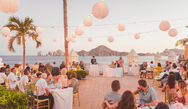 Bride and groom at their wedding reception by the ocean