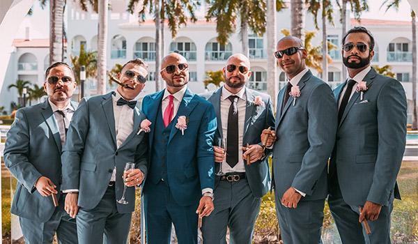 Groom standing next to his groomsmen