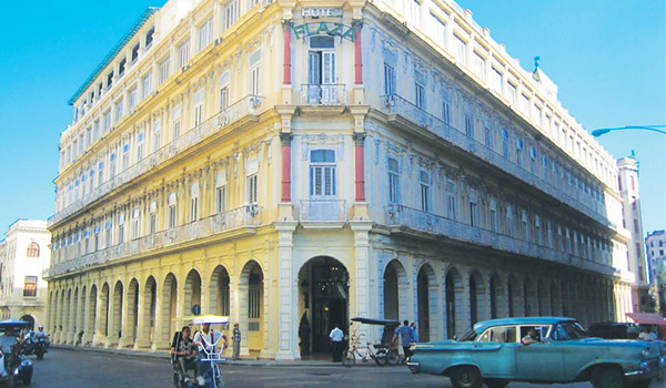 The entrance of the Hotel Plaza on the corner of a charming street in Old Havana