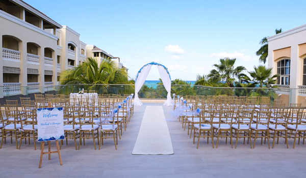 Wedding ceremony on a terrace surrounded by palm trees