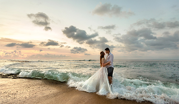 Wedding couple standing on the beach
