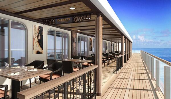Restaurant extérieur avec vue sur le côté du navire de croisière