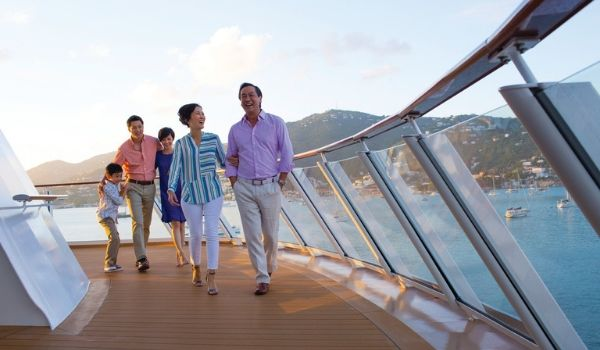 Multi-generational family walking along the ship's boardwalk