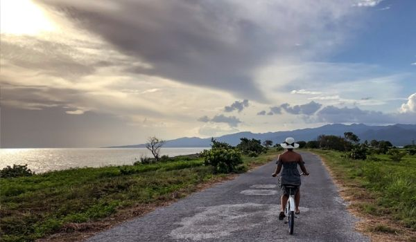 Woman cycling along bike path