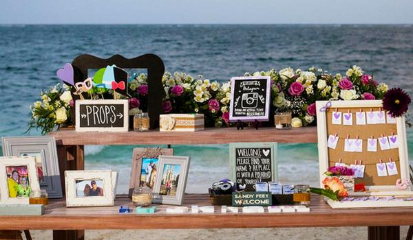 Polaroids on a table by the beach