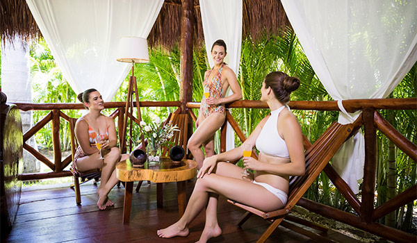 Tessa and her two friends getting a massage in an outdoor spa