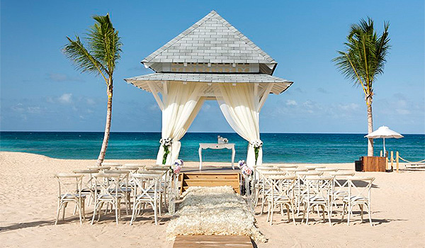 Gazebo on the beach surrounded by palm trees