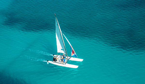 Aerial view of people sailing on a catamaran