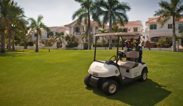Golf cart sitting on pristine greens