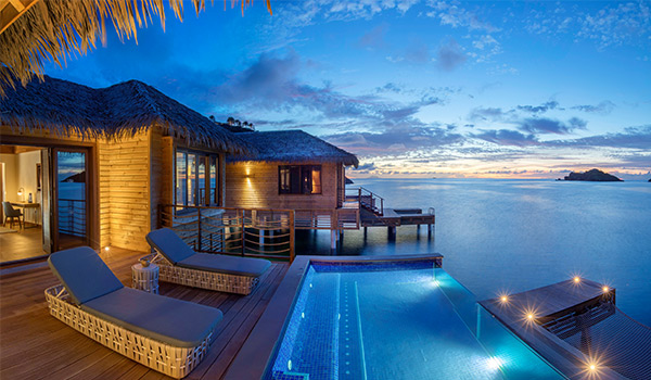 Plunge pool overlooking the ocean in a private bungalow at sunset