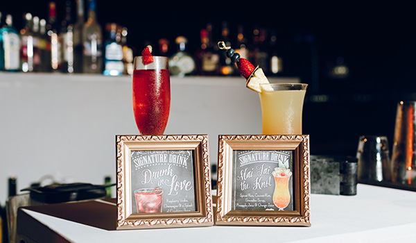 Pair of cocktails displayed on a table