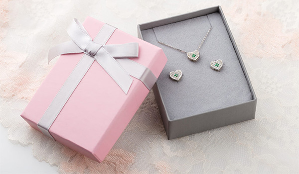 Jewelry box with a heart-shaped necklace and matching earrings