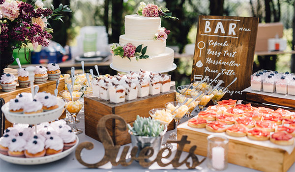 Dessert tables with cakes, cupcakes and champagne