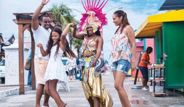 Family dancing with performer at Junkanoo