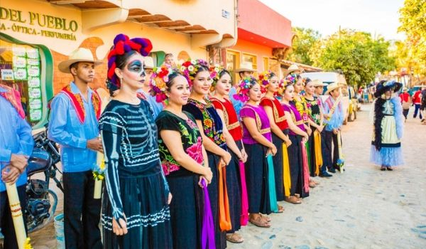 Group of people dressed up for Day of the Dead