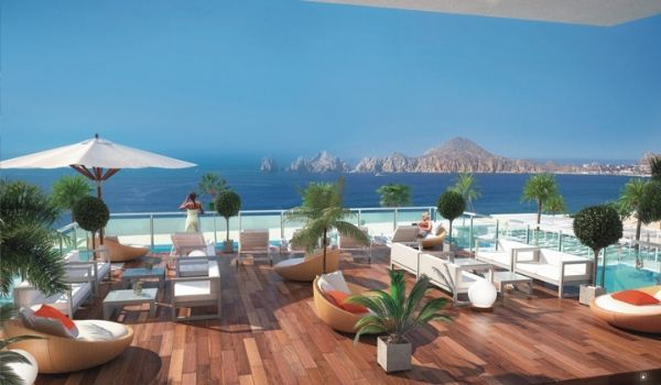 Rooftop lounge with infinity pool overlooking Los Cabos Arch