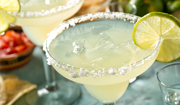 Margarita in a salt-rimmed glass with a lime wedge
