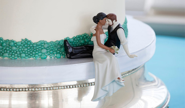Wedding cake with a custom bride and groom cake topper