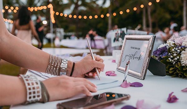Person signing a guestbook