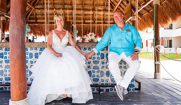Wedding couple sitting at a bar