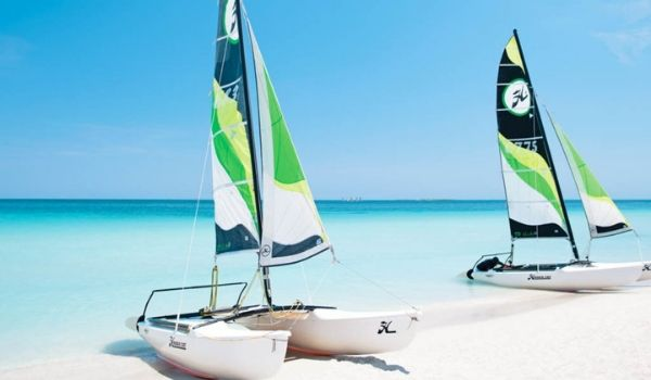 Two catamarans on a white-sand beach