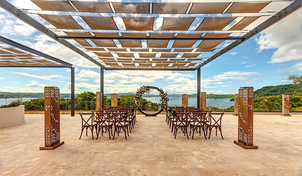 Wedding ceremony on a rooftop overlooking the ocean