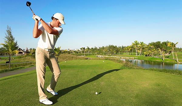 Golfer about to tee off on beautiful golf course