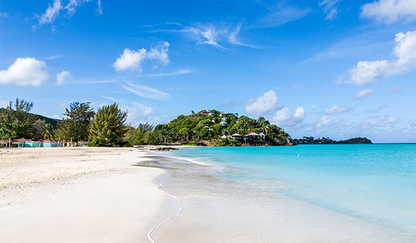 Waves lapping onto the shores at Jolly Beach in Antigua