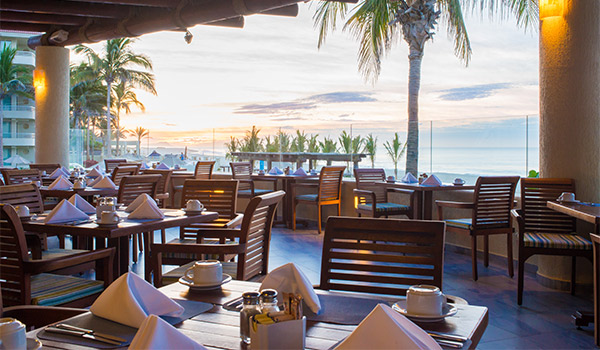 Restaurant by the ocean at sunset