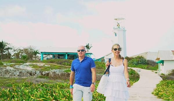 Dr. Nord and his wife walking through a garden