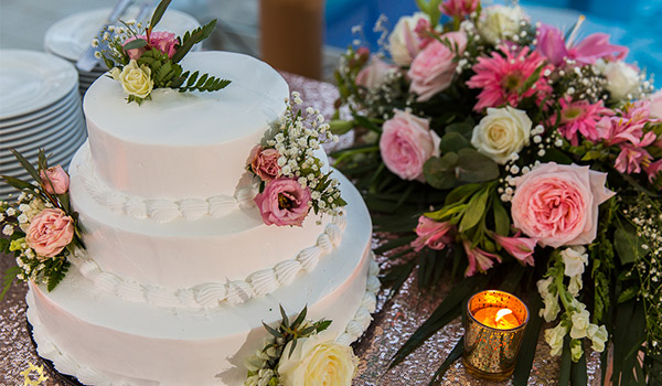 Wedding cake decorated with tropical flowers