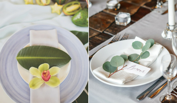 Place settings with a palm leaf on top of the plate