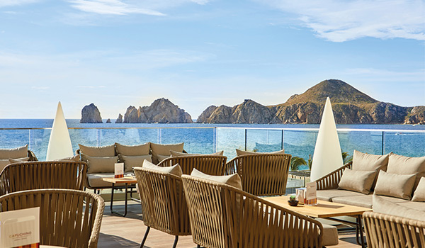 Cafe patio with comfortable seating overlooking the rocky arches of Los Cabos